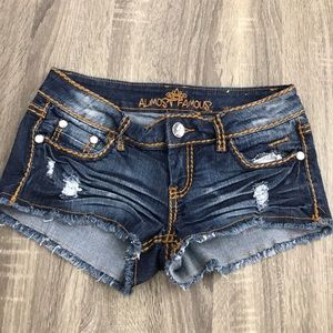 Dark jean short with jeweled accents